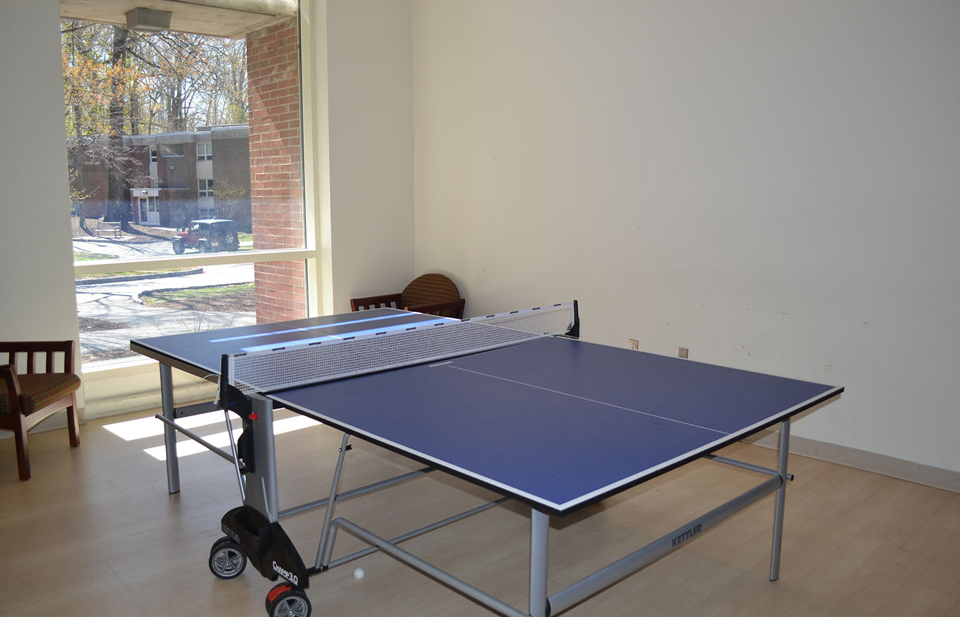 Ping pong and foosball tables in residence hall lounges