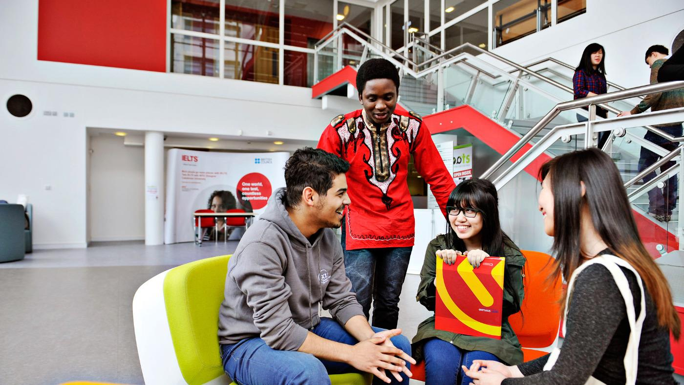 Students sitting in the INTO GCU Centre