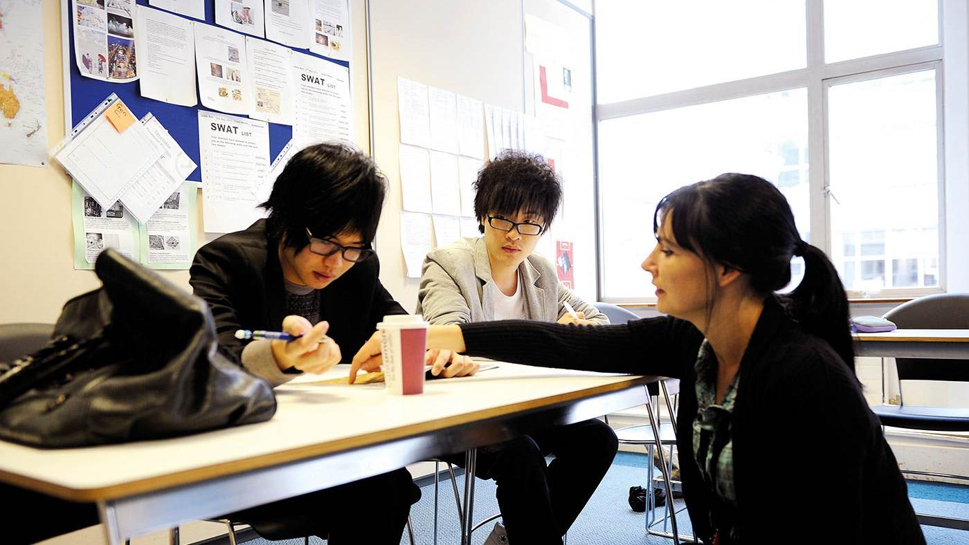 INTO Manchester students and teacher in classroom