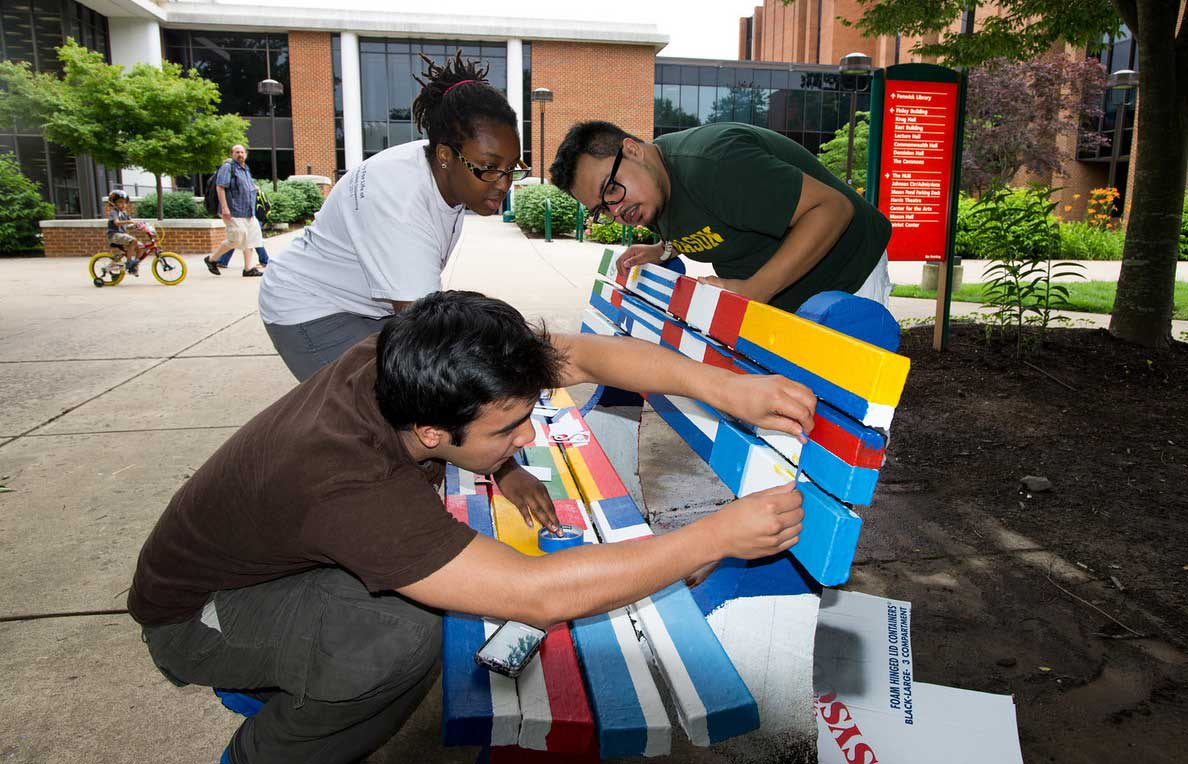 INTO George Mason students decorating campus