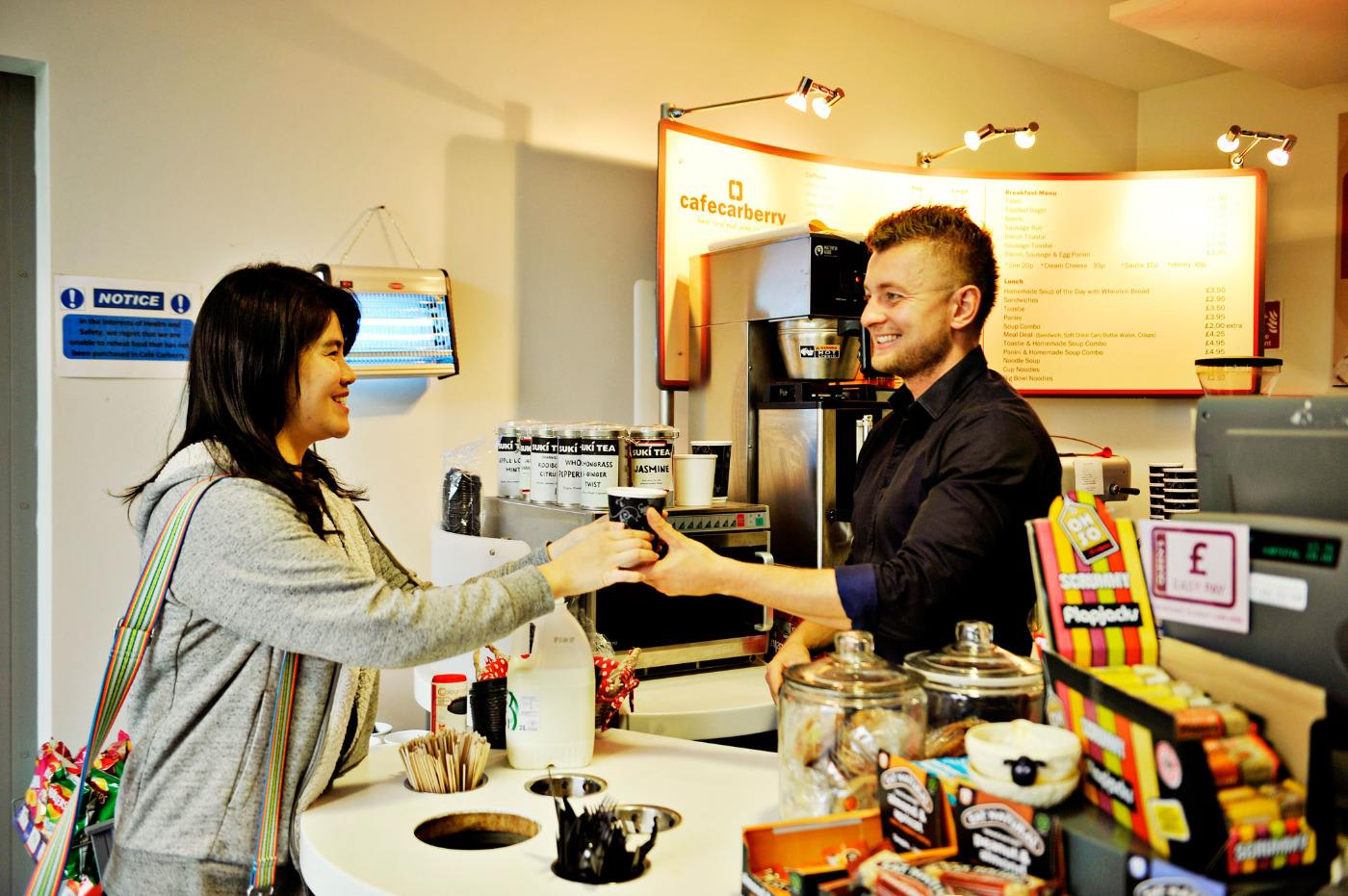 Student buying coffee on INTO Queen's campus