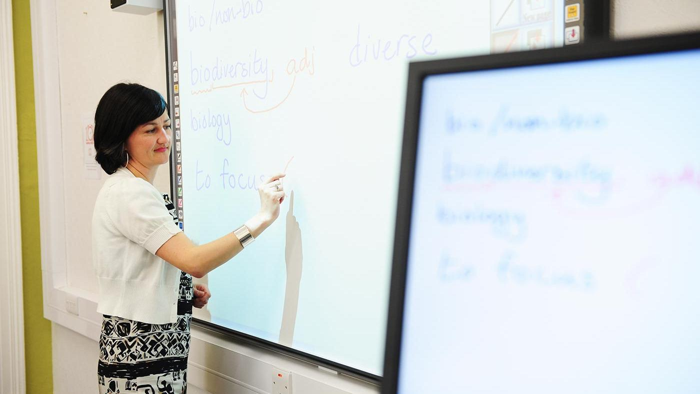 INTO Queen's teacher using smartboard