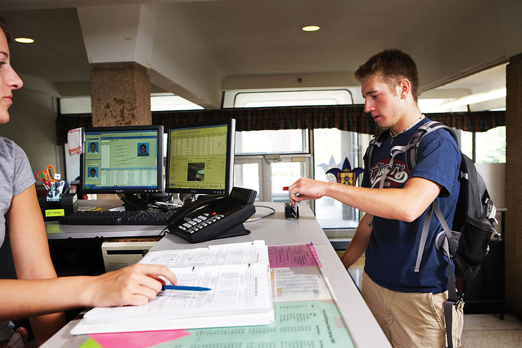 Students checks into residence hall