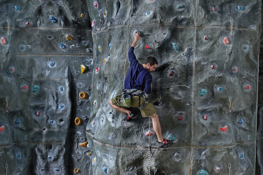 10m high climbing wall with bouldering cave