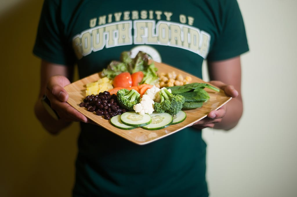 Student hold plate of food
