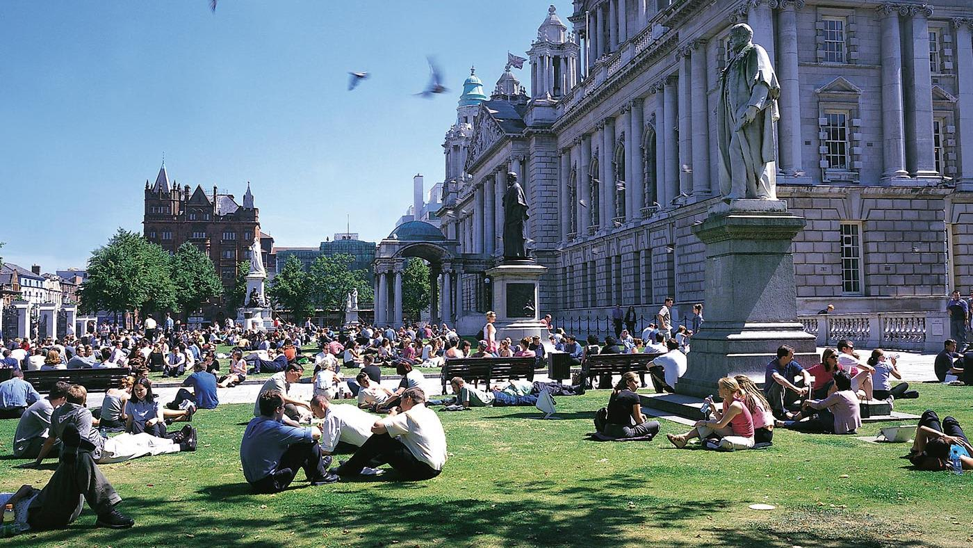 People on grass outside Belfast city hall