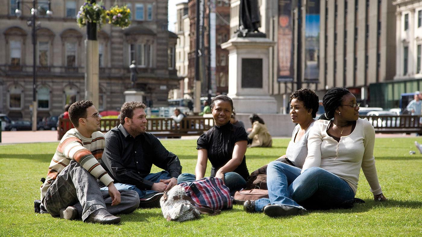 Students sitting on the grass in Glasgow