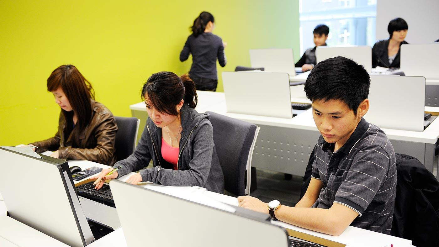 Students studying at INTO City University London