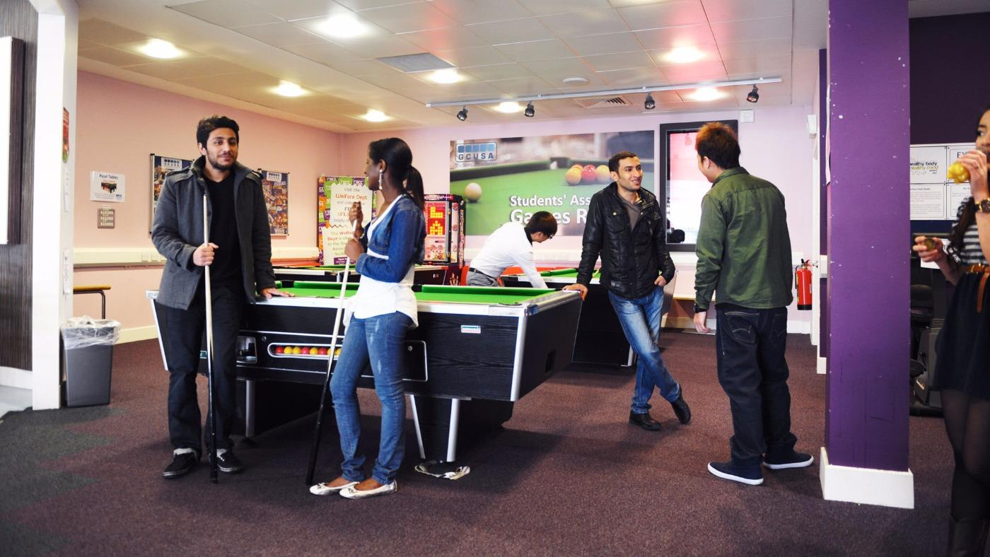 Students playing pool at INTO GCU
