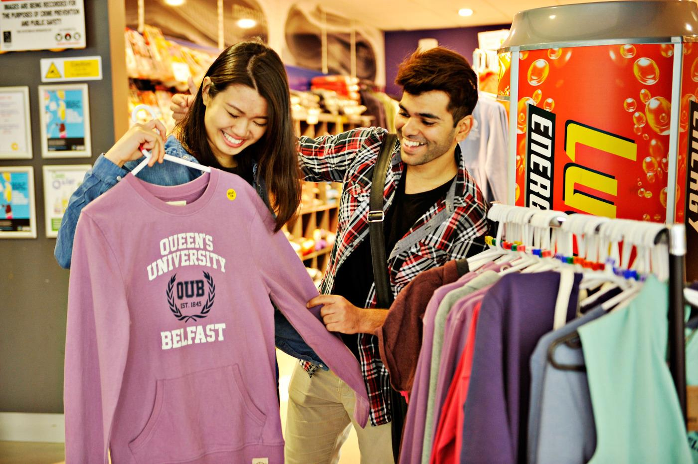 INTO Queen's students shopping on campus