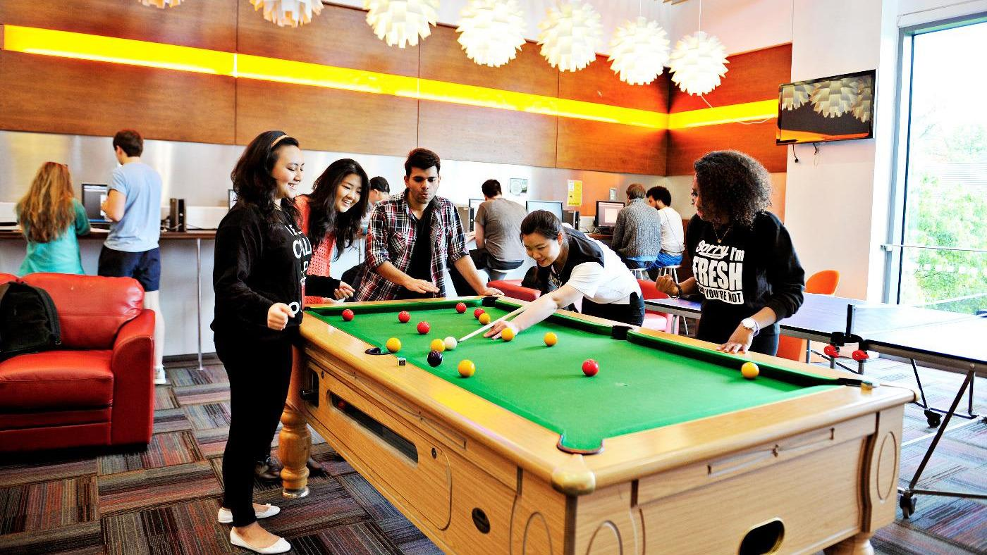 Students playing pool at INTO Queen's