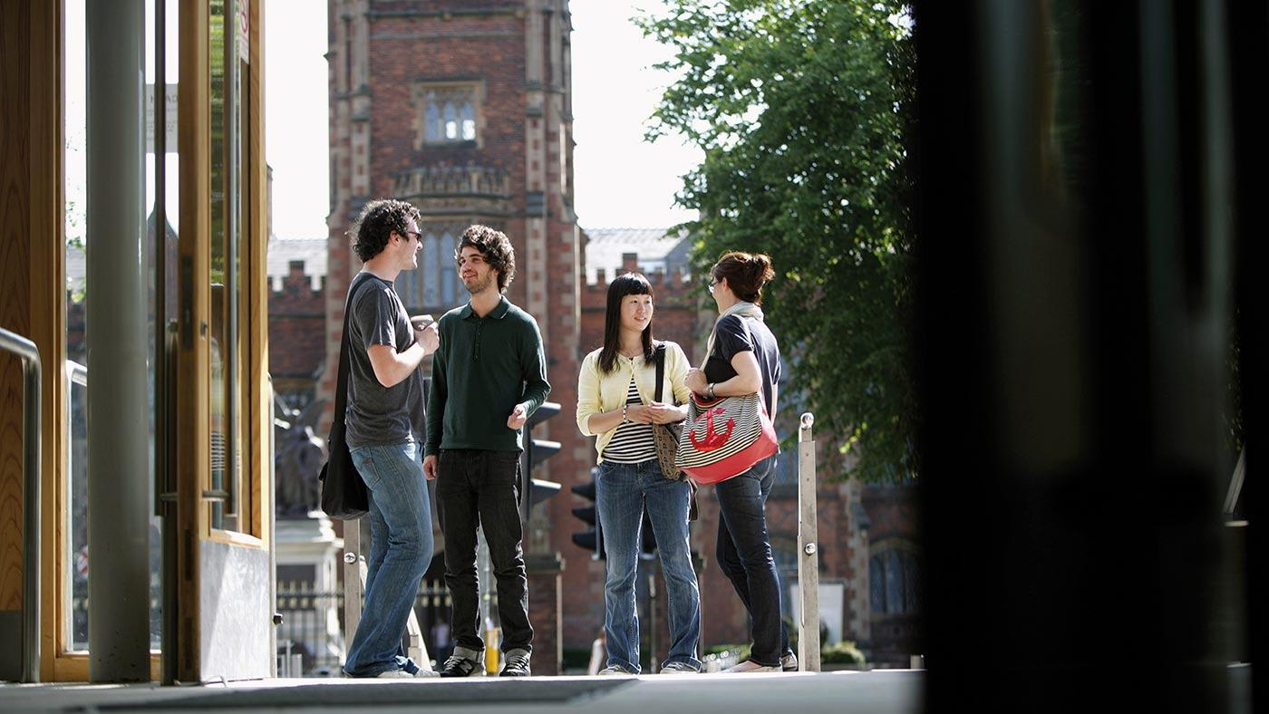 INTO Queen's students talking on campus