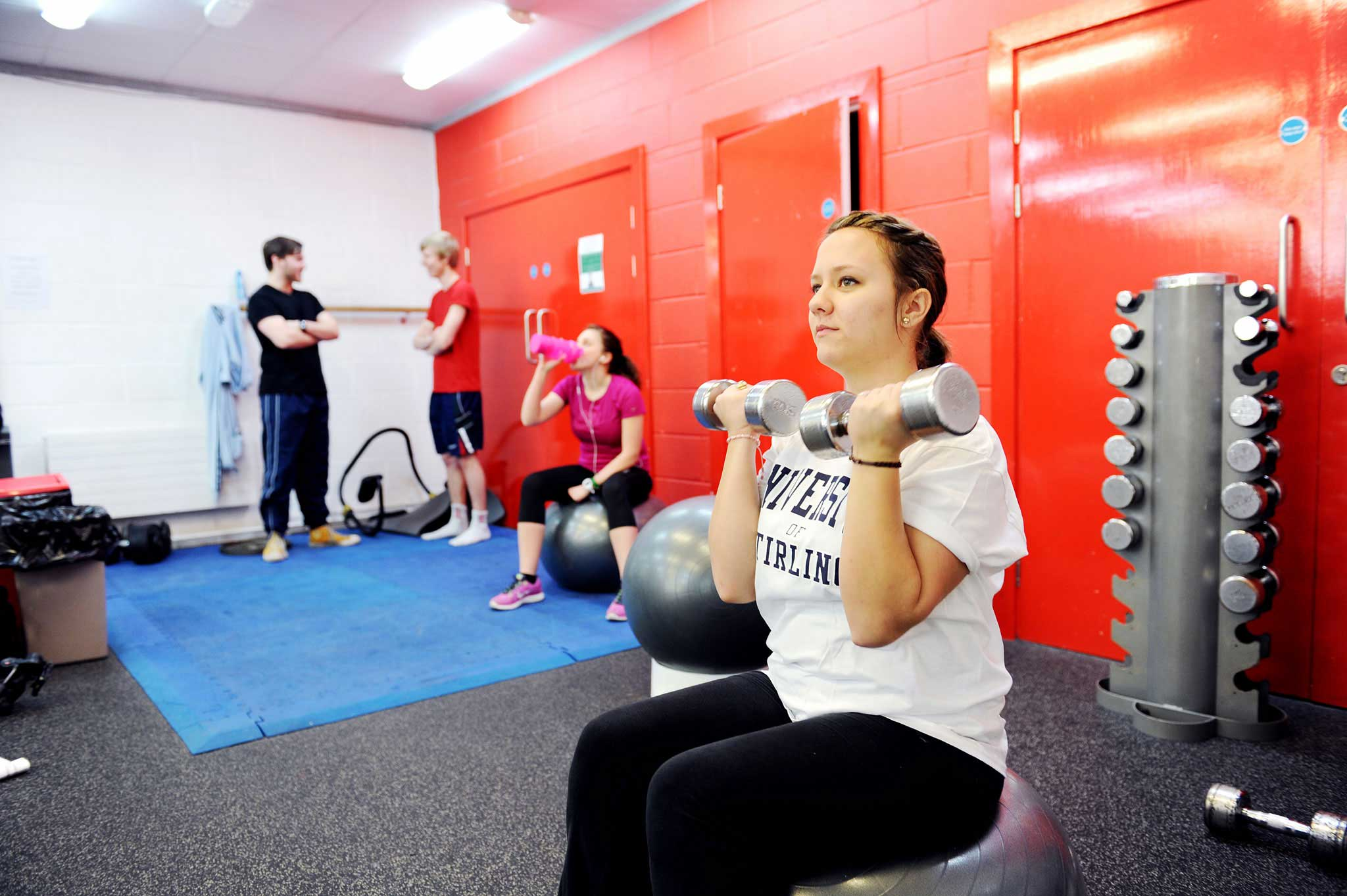 Students using the gym on campus
