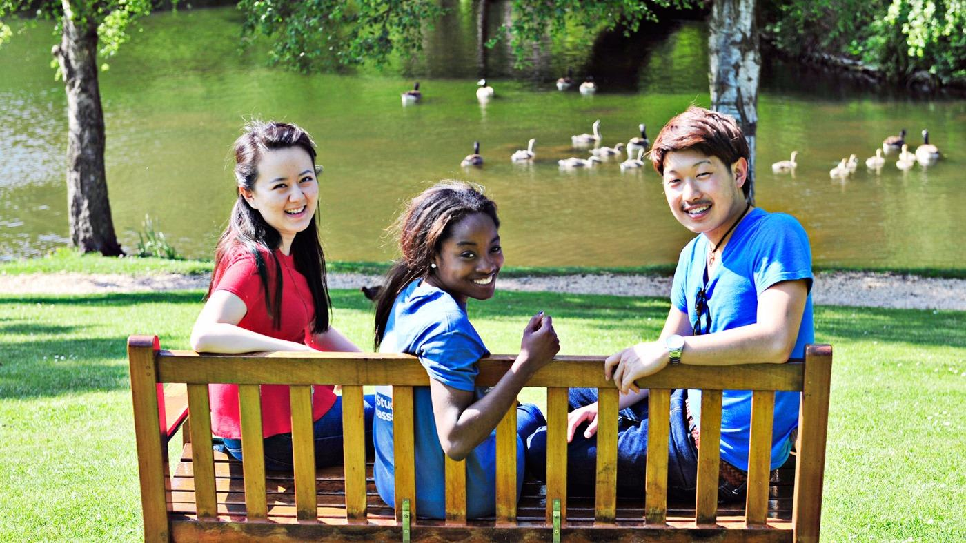 international students on campus with ducks