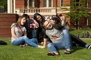 Students studying English on the grass
