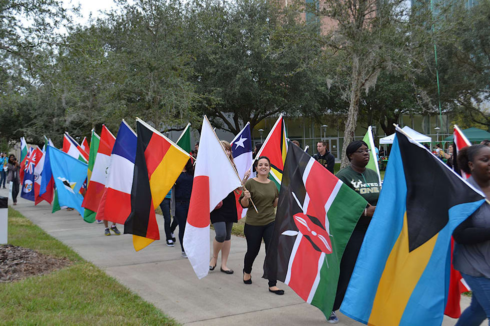 Students walking with national flags